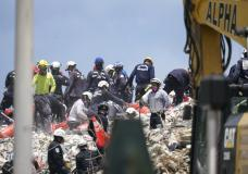 Workers search the rubble at the Champlain Towers South condo, Monday, June 28, 2021, in Surfside, Fla. Many people were still unaccounted for after Thursday's fatal collapse. (AP Photo/Gerald Herbert)