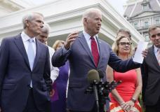 President Joe Biden, with a bipartisan group of senators, speaks Thursday June 24, 2021, outside the White House in Washington. Biden invited members of the group of 21 Republican and Democratic senators to discuss the infrastructure plan. (AP Photo/Jacquelyn Martin)