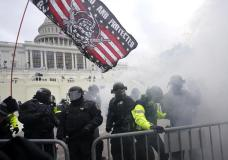 FILE - In this Jan. 6, 2021, U.S. Capitol Police officers hold off rioters loyal to President Donald Trump at the Capitol in Washington. (AP Photo/Julio Cortez, File)
