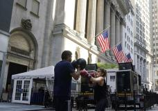 A woman and her trainer workout outside the New York Stock Exchange, Monday, June 7, 2021. Stocks are opening higher on Wall Street Thursday, June 10 nudging the S&P 500 back into the green for the week. The benchmark index was up 0.6% in the early going, and the tech-heavy Nasdaq was up 0.4%. (AP Photo/Richard Drew)