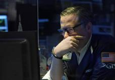 Specialist Gregg Maloney works on the floor of the New York Stock Exchange, Monday, July 19, 2021. Stocks are falling sharply Monday as worries sweep from Wall Street to Sydney that the worsening pandemic in hotspots around the world will derail what's been a strong economic recovery. (AP Photo/Richard Drew)