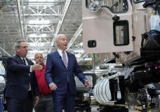 President Joe Biden reacts as Mack Trucks President Martin Weissburg, left, speaks during a tour of the Lehigh Valley operations facility for Mack Trucks in Macungie, Pa., Wednesday, July 28, 2021. UAW Local 677 Shop Chairman Kevin Fronheiser is at center. (AP Photo/Susan Walsh)