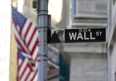 Flags adorn the facade of the New York Stock Exchange, Wednesday, June 16, 2021. Stocks are opening higher on Wall Street Friday, July 9, but the market is still on track to end this holiday-shortened week lower following two weeks of gains. (AP Photo/Richard Drew)