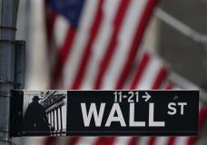 FILE - In this Nov. 23, 2020 file photo, a street sign is displayed at the New York Stock Exchange in New York. Stocks are opening lower on Wall Street Friday, July 30, 2021, putting the S&P 500 back in the red for the week. (AP Photo/Seth Wenig, File)