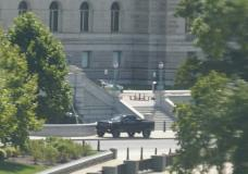 A pickup truck is parked on the sidewalk in front of the Library of Congress' Thomas Jefferson Building, as seen from a window of the U.S. Capitol, Thursday, Aug. 19, 2021, in Washington. A man sitting in the pickup truck outside the Library of Congress has told police that he has a bomb, and that's led to a massive law enforcement response to determine whether it's an operable explosive device. (AP Photo/Alex Brandon)