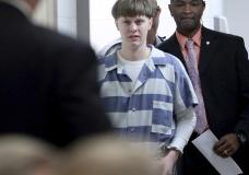 FILE - In this April 10, 2017, file photo, Dylann Roof enters the court room at the Charleston County Judicial Center to enter his guilty plea on murder charges in Charleston, S.C. A federal appeals court on Wednesday, Aug. 25, 2021, upheld Roof's conviction and sentence on federal death row for the 2015 racist slayings of nine members of a Black South Carolina congregation. A three-judge panel of the 4th U.S. Circuit Court of Appeals in Richmond affirmed Roof's conviction and sentence in the shootings at Mother Emanuel AME Church in Charleston. (Grace Beahm/The Post And Courier via AP, Pool, File)