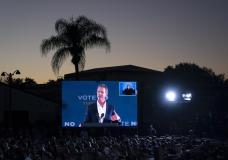 A large screen shows California Gov. Gavin Newsom as he speaks at a rally ahead of the California gubernatorial recall election Monday, Sept. 13, 2021, in Long Beach, Calif. (AP Photo/Jae C. Hong)