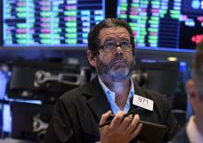 Trader James Macgilvray works on the floor of the New York Stock Exchange, Tuesday, Sept. 21, 2021. Stocks are opening modestly higher on Wall Street, making up some of the ground they lost in a sharp pullback a day earlier. (AP Photo/Richard Drew)