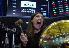 A.k.a Brands CEO Jill Ramsey rings the ceremonial first trade bell as her company's stock begins trading, on the floor of the New York Stock Exchange, Wednesday, Sept. 22, 2021. (AP Photo/Richard Drew)