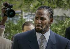 """FILE - This photo from Friday May 9, 2008, shows R. Kelly arriving for the first day of jury selection in his child pornography trial at the Cook County Criminal Courthouse in Chicago. R. Kelly, the R&B superstar known for his anthem """"I Believe I Can Fly,"""" was convicted Monday in a sex trafficking trial after decades of avoiding criminal responsibility for numerous allegations of misconduct with young women and children. (AP Photo/Charles Rex Arbogast, File)"""