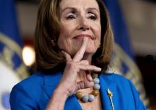 House Speaker Nancy Pelosi of Calif. reacts as she listens to a question from a reporter during her weekly press briefing on Capitol Hill, Thursday, Sept. 30, 2021, in Washington. (AP Photo/Andrew Harnik)