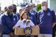 New York Gov. Kathy Hochul, center is joined by Mayor Bill de Blasio, right, during a news conference near a home where people were killed when their basement apartment was flooded in the Jamaica neighborhood of the Queens borough of New York, Thursday, Sept. 2, 2021, in New York. The remnants of Hurricane Ida dumped historic rain over New York City as freeways and boulevards turned into rivers, submerging cars.(AP Photo/Mary Altaffer)