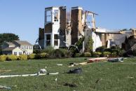 Homes damaged from the remnants of Hurricane Ida on Josephine Lane in Mullica Hill, N.J. on Thursday, Sept. 2, 2021. (Monica Herndon/The Philadelphia Inquirer via AP)