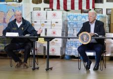 President Joe Biden listens as New Jersey Gov. Phil Murphy, left, speaks during a briefing about the impact of Hurricane Ida, Tuesday, Sept. 7, 2021, in Hillsborough Township, N.J. (AP Photo/Evan Vucci)