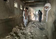 People inspect the inside of a mosque following a suicide bombers attack in the city of Kandahar, southwest Afghanistan, Friday, Oct. 15, 2021. Suicide bombers attacked a Shiite mosque in southern Afghanistan that was packed with worshippers attending Friday prayers, killing several people and wounding others, according to a hospital official and a witness. (AP Photo/Sidiqullah Khan)