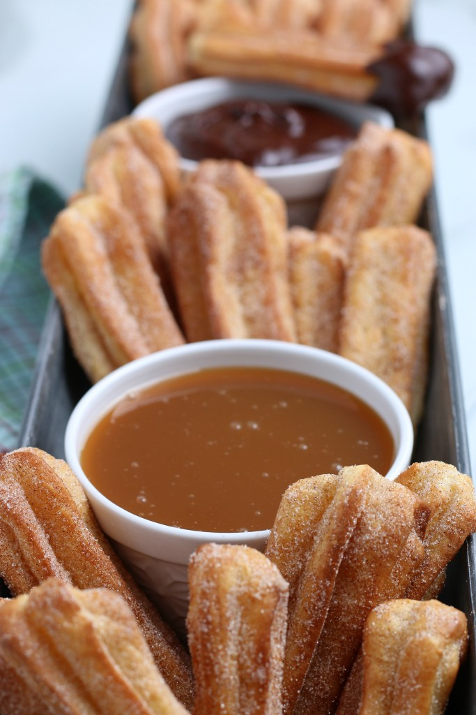 close up shot of air fryer churros and dipping sauces