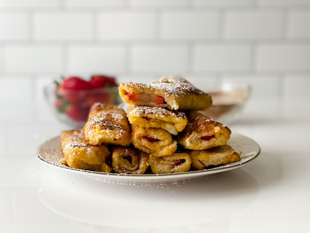 stuffed french toast stacked up and dusted with powdered sugar