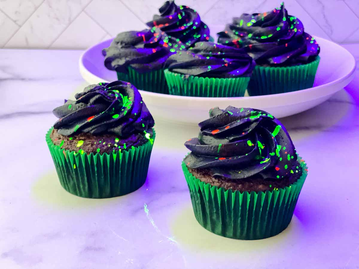 glow in the dark cupcakes with green liners and glowing splatters