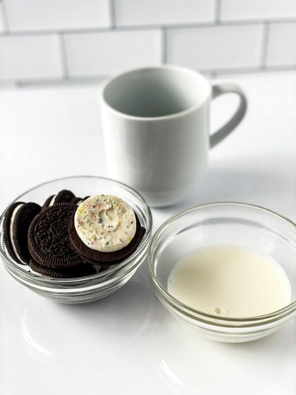 ingredients for oreo cake in a mug