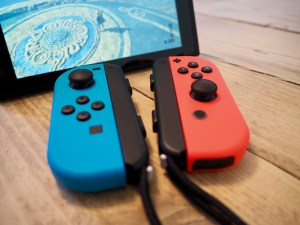 Nintendo Switch with detached Joy-Con controllers and wrist straps