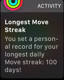 A notification on the Apple Watch, congratulating the user on reaching a 100 day Move streak.