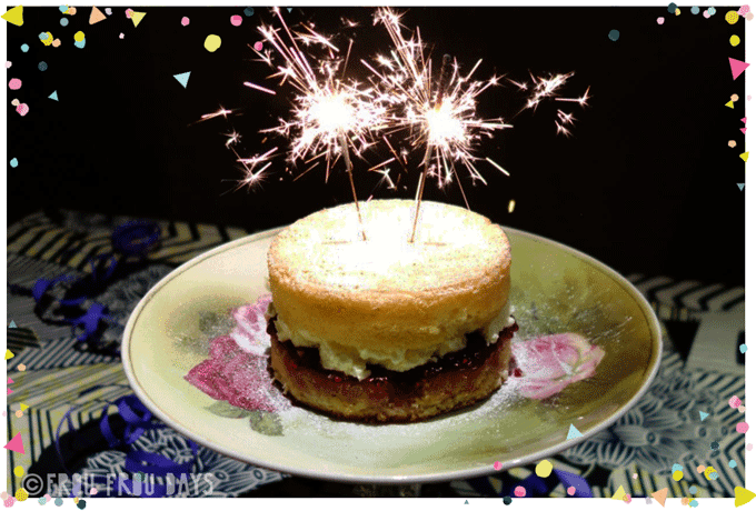 birthday cake with two sparklers