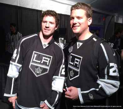 Center Colin Fraser (left) with a fan