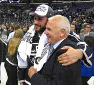 Defenseman Alec Martinez (background left) and LA Kings Senior Advisor/Development Coach Mike O'Connell (foreground right)