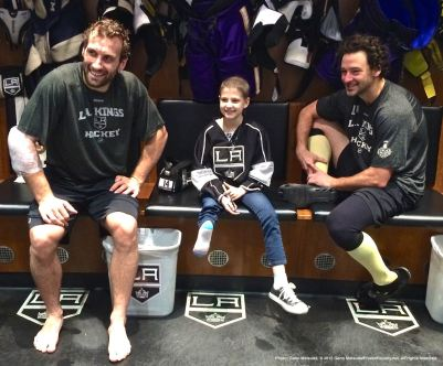 LA Kings center Jarret Stoll (left) and right wing Justin WIlliams (right), shown here with nine-year-old cancer patient Grace Bowen.