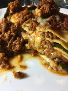 Gluten free lasagna pasta layered with mozarella cheese, spinach and a rich homemade bolognese sauce