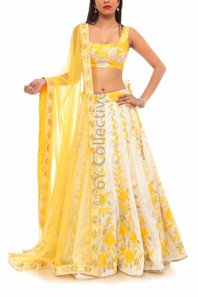 Team this summery yellow embroidered Lehenga with statement gold pieces to look absolutely radiant