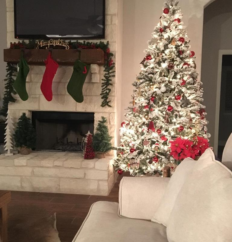 Christmas Tree and Stockings Hung on Rock Fireplace