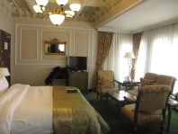 king sized bed and sitting area in suite hotel in Istanbul