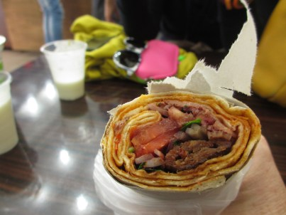Turkish kebab with meat, vegetables and yoghurt drink in background