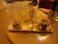 silver salver with Turkish coffee, Turkish delight, glass of water, almond liquour