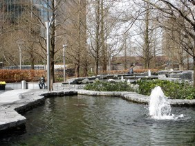 gardens with bare trees and pond with fountain