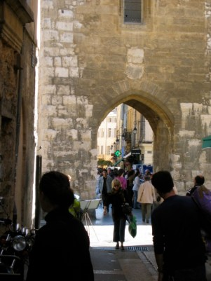 Archway with woman walking through it in the shadow