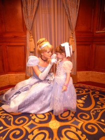 Little girl with Cinderella at Disney World - A Frugal Mom's Guide To Disney - 10 Ways To Save At Disney