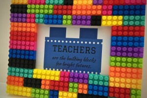 "Lego frame and gift bag with gift tag that reads "" Teachers are the building blocks for bright futures"" - 7 Teacher Gifts With Printable Gift Tags"