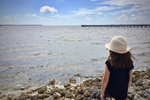 Young girl looking out at the water - Two Simple Words That Made Me A Nicer Mom