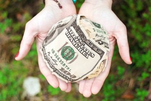 money in hand - How To Make Your Disaster Relief Donations Really Count