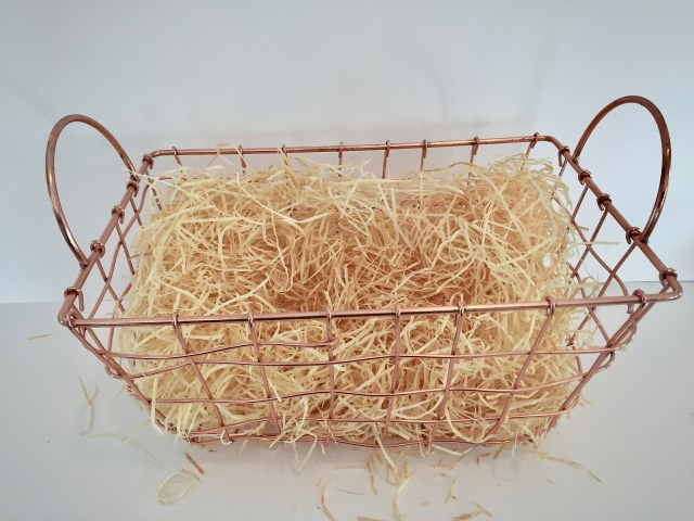 Unforgettable diy gift baskets that you can afford a few good looking and inexpensive options are raffia the crinkled grass used in easter baskets and tissue paper depending on the look of your basket negle Choice Image