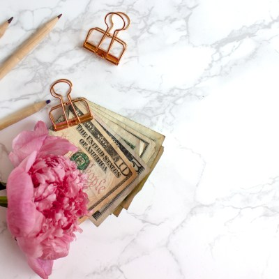 5 Steps To kickstarting a year of saving including decluttering, removing spending triggers, paying off holiday debt, starting a budget and using rebate apps.