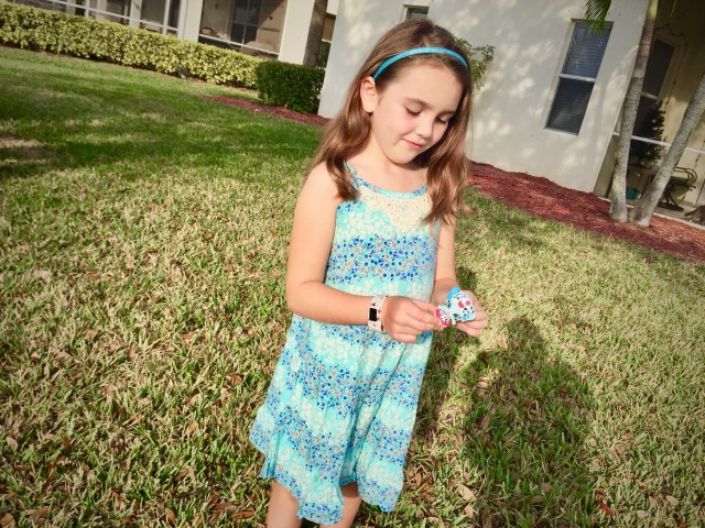 Girl standing in blue floral dress - This Frugal Mom's Favorite Subscription Box