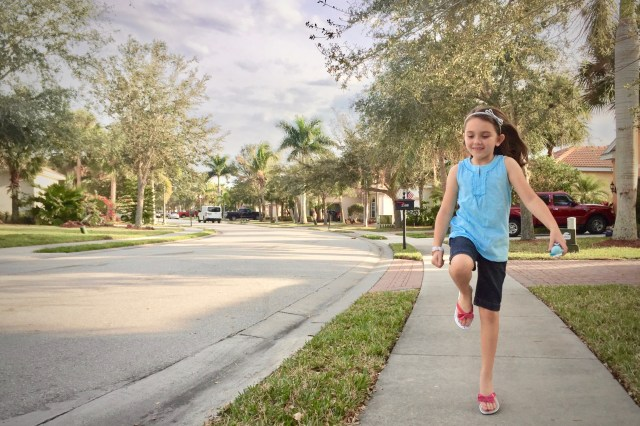 Girl skipping down a sidewalk - This Frugal Mom's Favorite Subscription Box