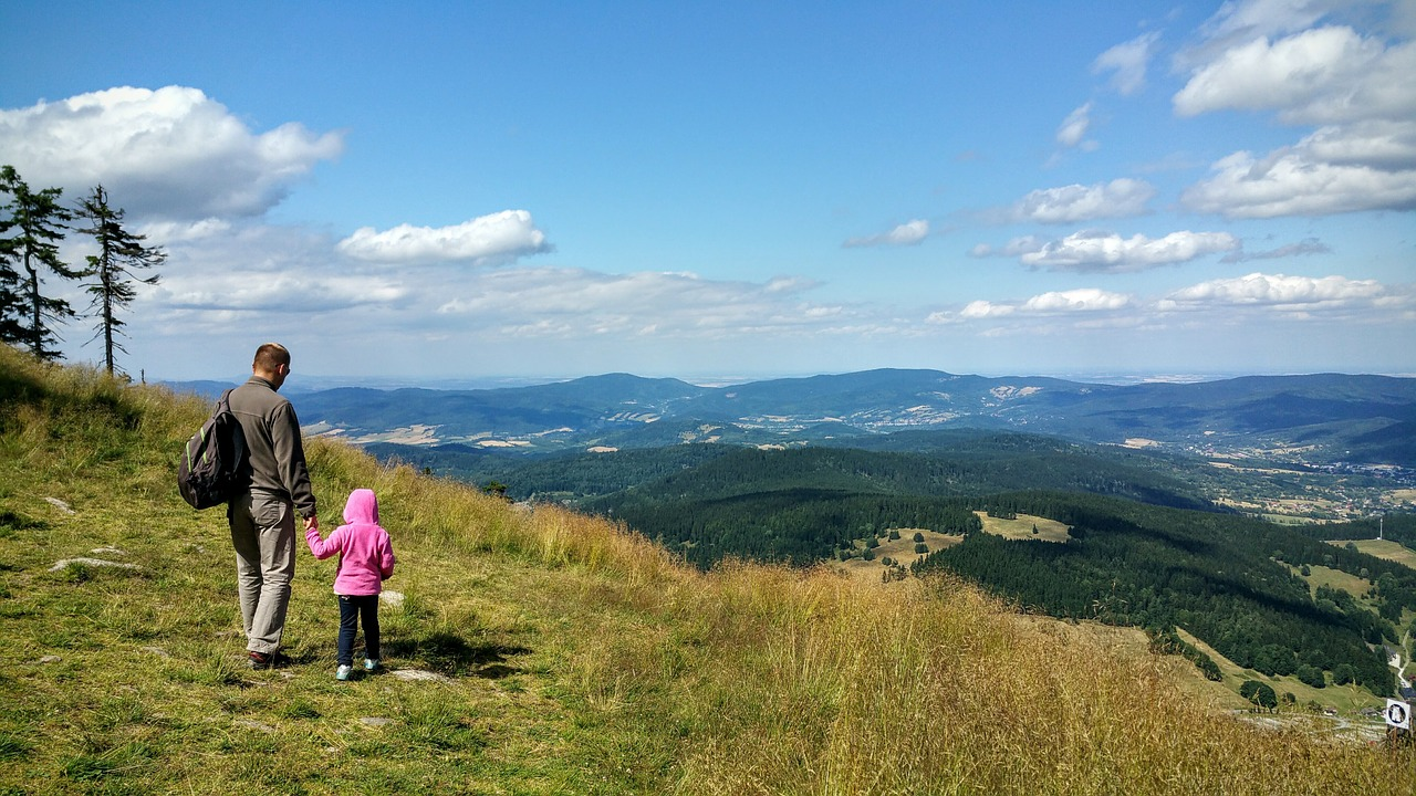 Father & daughter hiking - Giant List Of Family Activities For A No-Spend Weekend