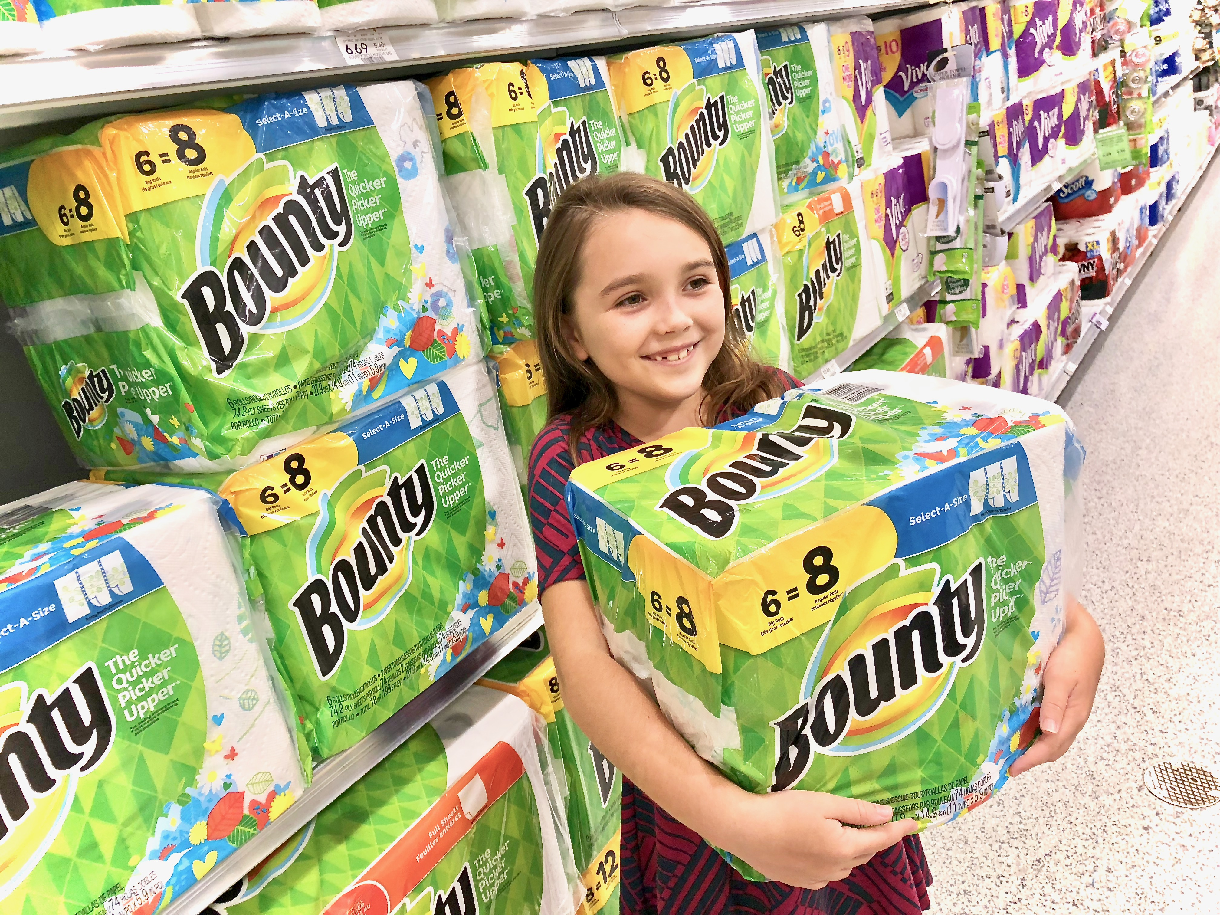 Girl with big case of Bounty paper towel rolls - Get Easy Cash Back On P&G Products At Publix