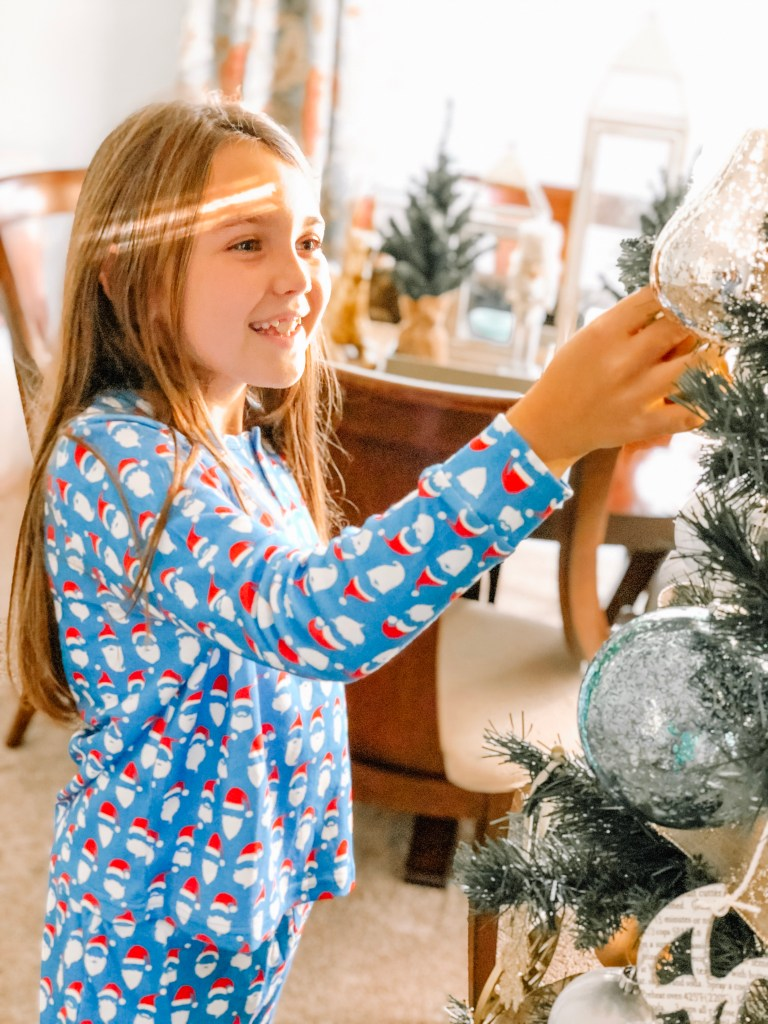 Decorating the tree - 20 Christmas Traditions Your Kids Will Remember When They're Older
