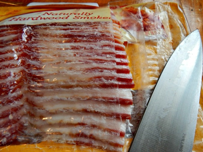 Slice though bacon while frozen, then return to freezer.