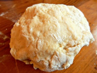 This is foolproof. It will absorb as much liquid as it needs to. Don't force or knead it. Use the dough ball to pick up odd pieces like an eraser. Ball should not feel sticky, but just a little tacky, not dry or tough. If you have time, cover and rest 15 minutes.
